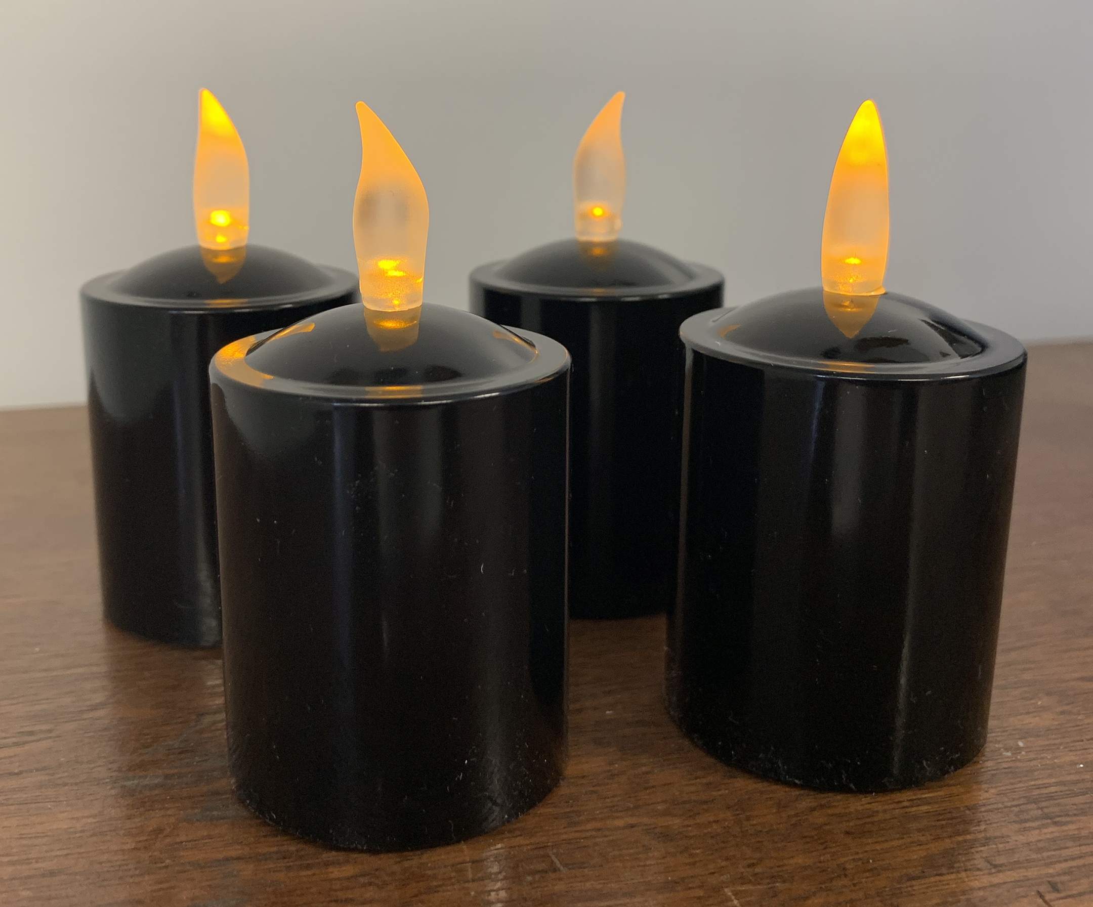 Set of 4 Spooky Black Votive Candles with Flickering Amber LEDs